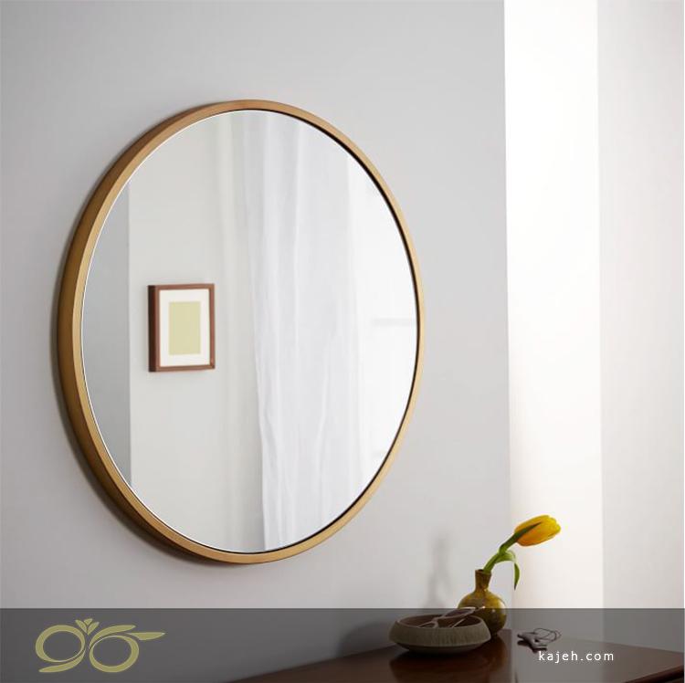 چگونه با نصب آینه روی دیوار، فضای خانه بزرگ تر جلوه می کند؟